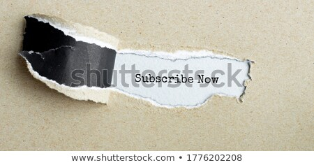 Newsletter text appearing behind torn brown paper Stock photo © DenisMArt