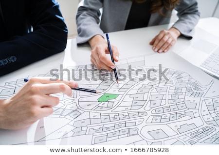 Main humaine crayon ville carte Photo stock © AndreyPopov