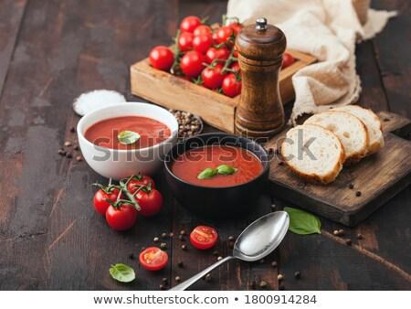Ceramiczne puchar płyty kremowy zupa pomidorowa łyżka Zdjęcia stock © DenisMArt