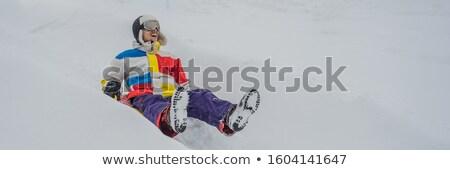 man snow tubing from hill. winter activity concept BANNER, LONG FORMAT Stock photo © galitskaya