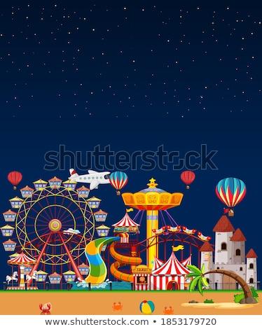 Amusement park scene at night with blank dark blue sky Stock photo © bluering