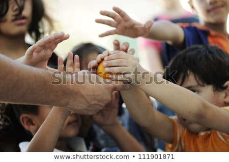 Stock photo: Hungry children in refugee camp, distribution of humanitarian food