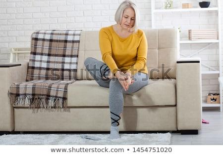 Nő sebes láb gyönyörű fiatal üzletasszony Stock fotó © piedmontphoto