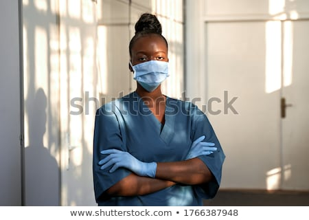 Closeup of a serious female medic in scrubs Stock photo © photography33