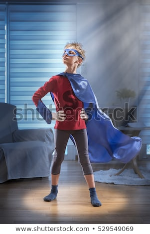 Stock photo: Young boy with hands on his hip