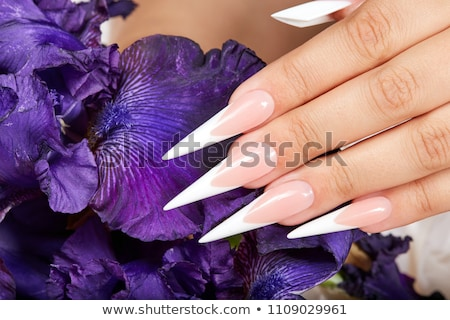 hands with long acrylic nails stock photo © dolgachov