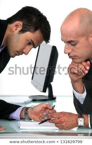 Dois empresários prova leitura final proposta Foto stock © photography33
