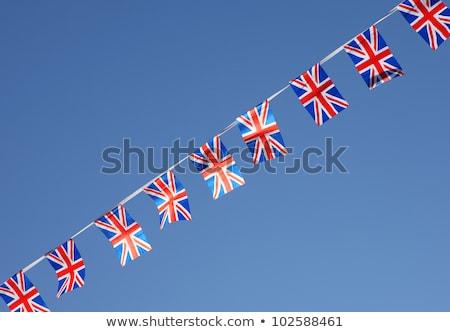Pequeno britânico union jack celebração bandeiras azul Foto stock © latent