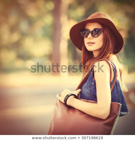 Beautiful redhead girl in the park. Stock photo © Massonforstock