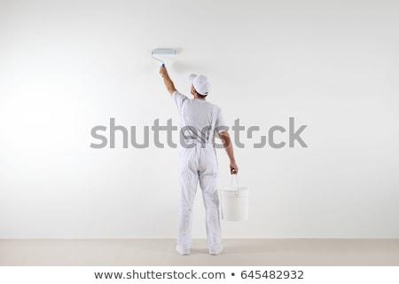 Сток-фото: человека · Живопись · стены · лице · работник · Hat