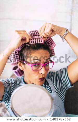Woman with curlers and lipstick Stock photo © photography33