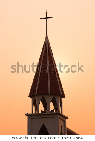 steeple cross at sunset stock photo © kenneth_keifer