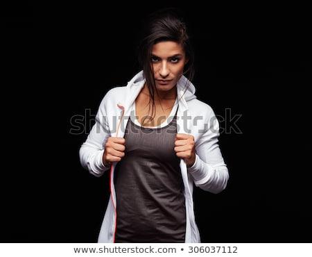 Donna atteggiamento guardando fotocamera giovani moda Foto d'archivio © feedough