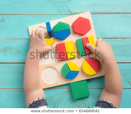 Toddler playing with a shape sorter Stock photo © photography33