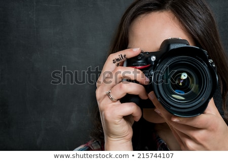Woman with a DSLR camera Stock photo © photography33