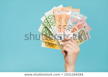 hand with euro stock photo © shutswis