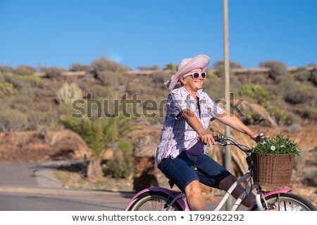 Active happy retired woman sky background Stock photo © roboriginal