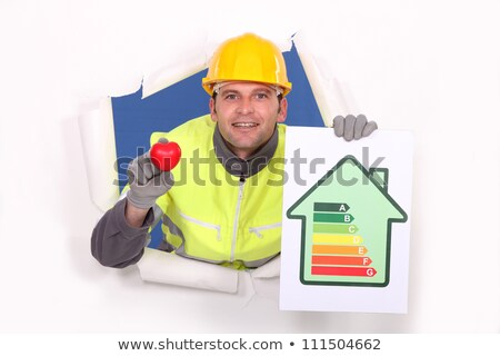 A mason promoting energy savings. Stock photo © photography33