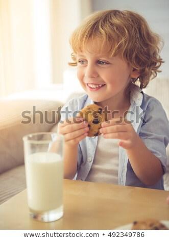 Vidám fiú eszik kekszek iszik tej konyha Stock fotó © wavebreak_media