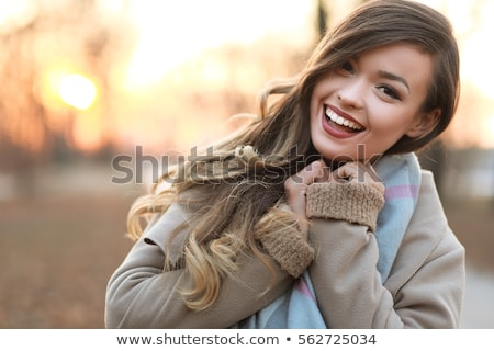 Portrait of a half-smiling woman stock photo © photography33