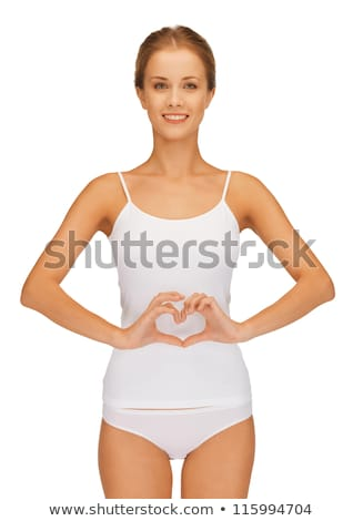 woman in cotton undrewear forming heart shape stock photo © dolgachov