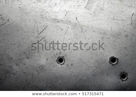bullet holes on metal plate stock photo © arcoss