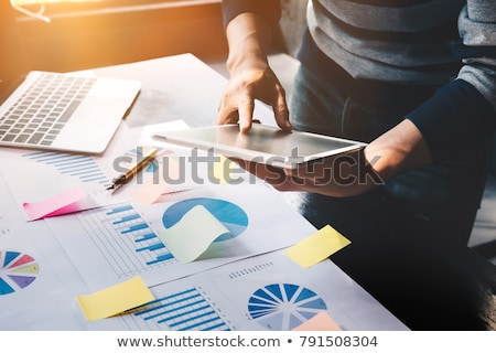 Foto stock: Desk With Digital Tablet Marketing Research