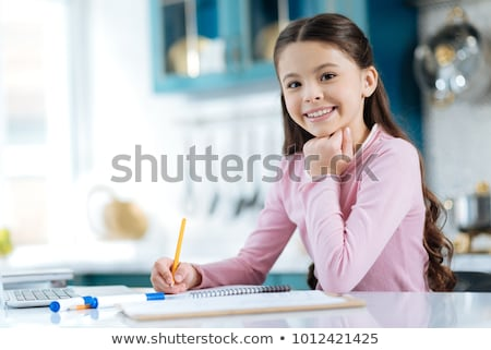 Stock photo: Beautiful little girls, homework at home