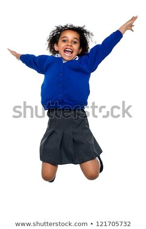 空中で高くジャンプするスマートキッド ストックフォト © stockyimages