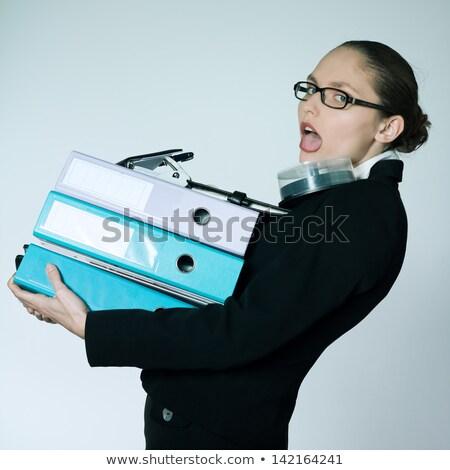 Stúdiófelvétel portré üzletasszony hordoz nehéz akták Stock fotó © pxhidalgo