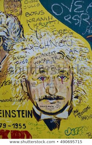 part of berlin wall with graffiti stock photo © photocreo