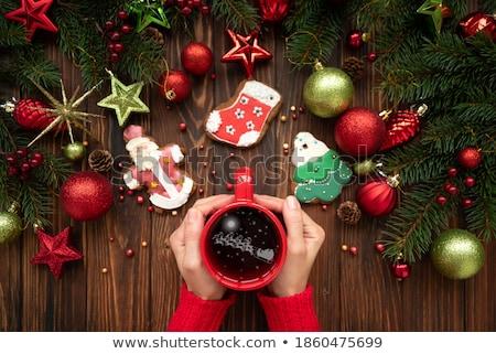 Kobieta hot kubek herbaty cookie Zdjęcia stock © artjazz