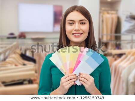 Young beautiful woman holding color palette  Stock photo © luckyraccoon