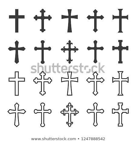 Katolikus kereszt sziluett temető alkonyat sziget Stock fotó © smithore