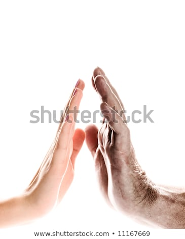 Hands of young woman and elderly man over white background Stock photo © Nejron