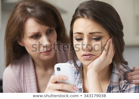 Mother Comforting Daughter Victimized By Online Bullying Stock photo © HighwayStarz