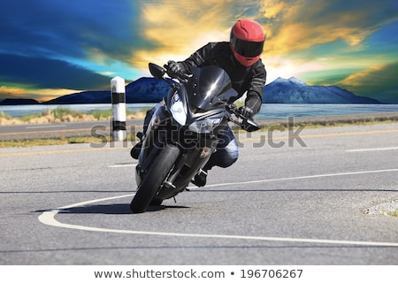 Foto stock: Young Man Riding A Sport Motorcycle On The Road