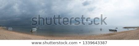 sötét · felhős · viharos · égbolt · felhők · hullámok - stock fotó © aetb