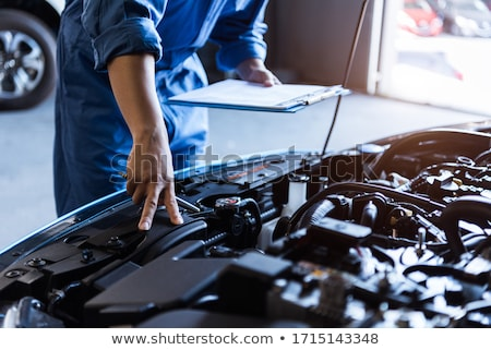 customer and car mechanic in auto workshop Stock photo © Kzenon