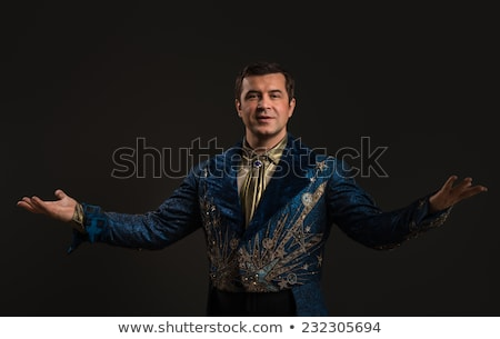 Handsome mature illusionist or wizard or magician conjuring  Stock photo © HASLOO