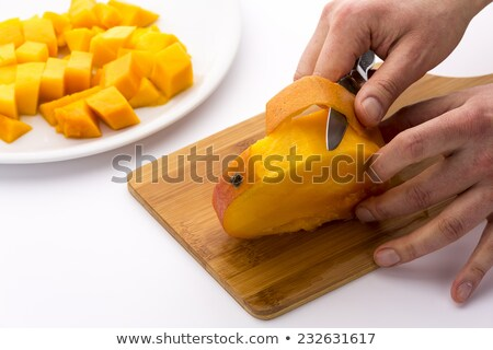 Mango cięcia trzy równy plastry owoców Zdjęcia stock © leowolfert