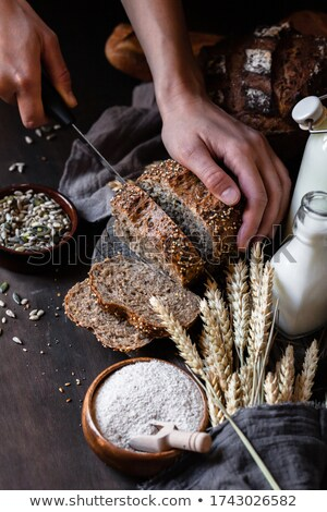Knife Cutting Whole Grain Bread Stock photo © milsiart