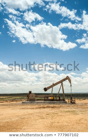 oil pumps on cloud sky stock photo © ssuaphoto