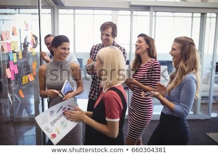 Zakenman merkt zelfklevend papier man Stockfoto © AndreyPopov