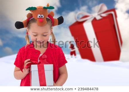 Cute little girl wearing rudolph headband Stock photo © wavebreak_media