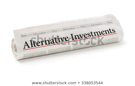 Rolled newspaper with the headline Alternative Investments Stock photo © Zerbor