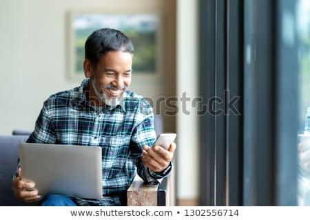 érett · ázsiai · férfi · számítógéphasználat · notebook · portré - stock fotó © szefei