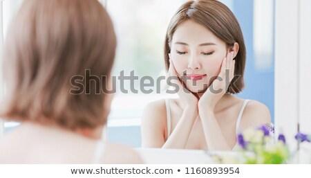 Gülen çekici genç kadın dokunmak yanak güzellik Stok fotoğraf © deandrobot