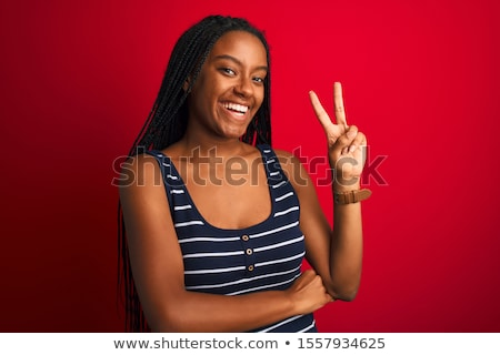 Woman showing fingers at camera and winking  Stock photo © deandrobot