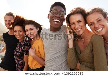Mutlu birlikte üç genç beyaz Stok fotoğraf © runzelkorn